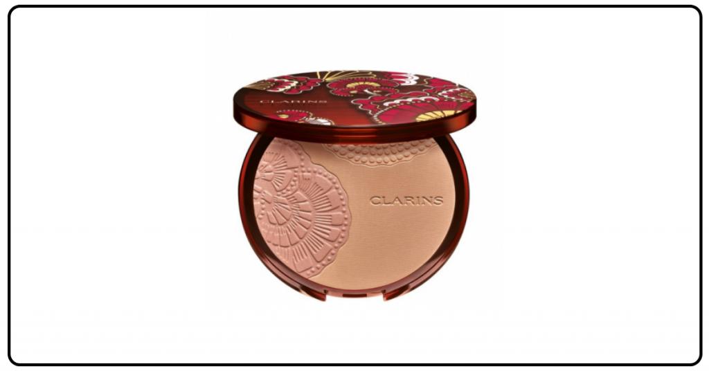 polvos compacto bronceadores para la cara de color marron oscuro vienen en la clasica cajita redonda con espejo