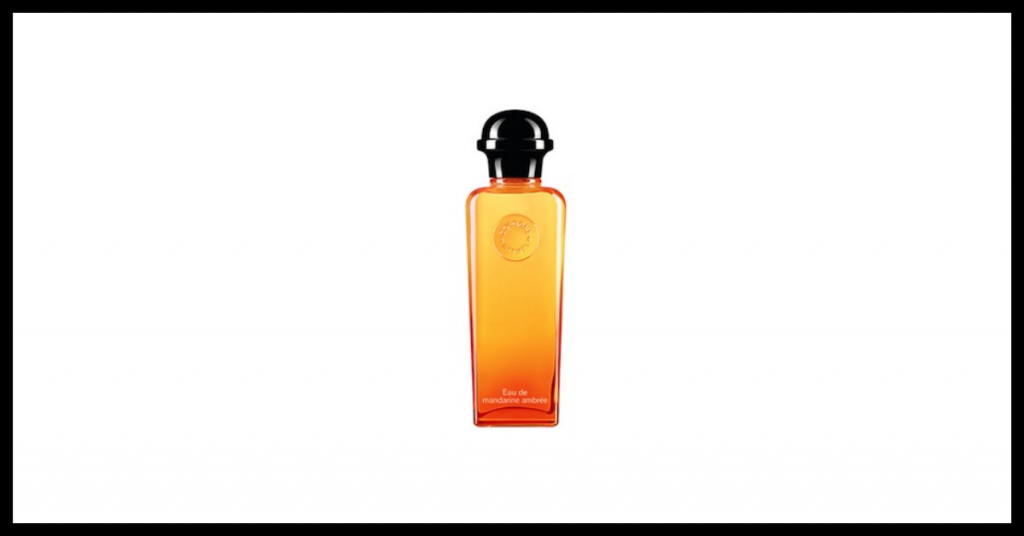 bote de agua de perfume de hermes es naranja desde arriba hasta la parte inferior que se vuelve rojo el tapon es negro
