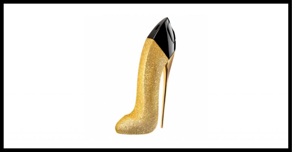 frasco de colonia con forma de tacon dorado con la parte de arriba negra de la marca Carolina Herrera