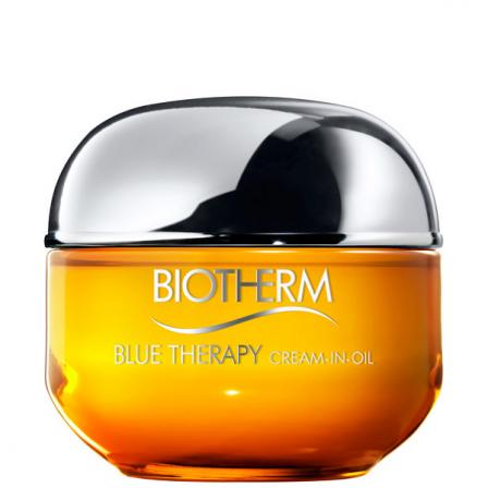crema con aceite para la cara en bote color naranja y amarillo y tapon plateado con letras plateadas de la marca biotherm