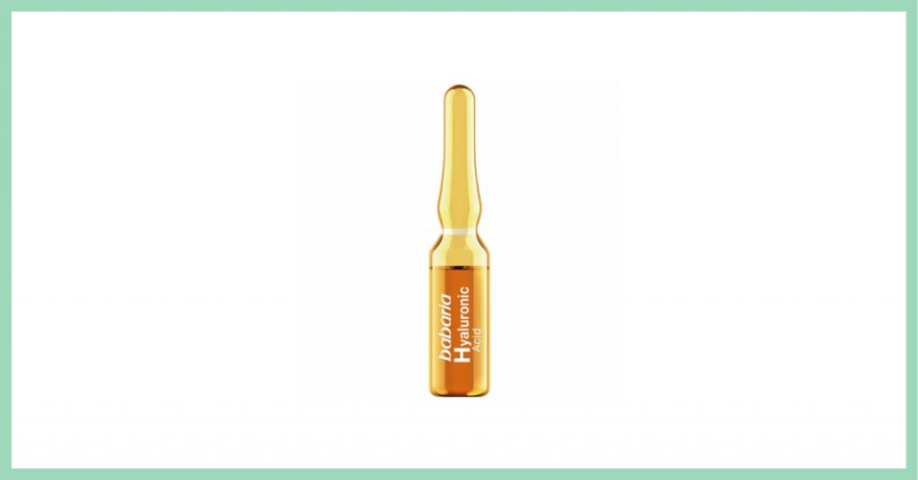 ampolla cosmética para el rostro en un pequeño recipiente de cristal color amarillo con etiqueta naranja de la marca Babaria